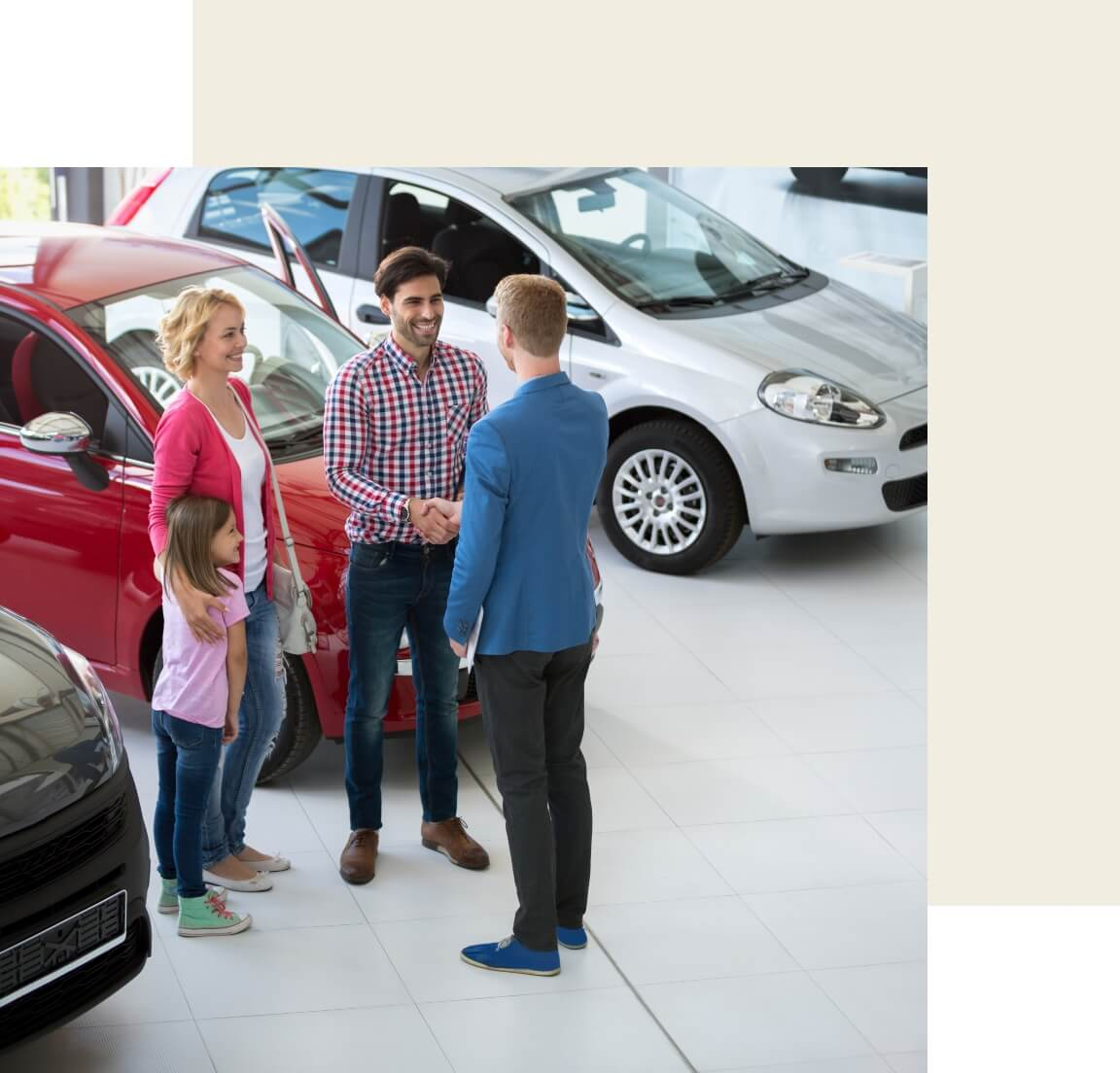 A car salesman talking to a family
