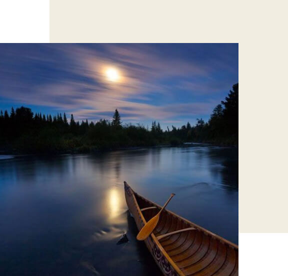A canoe on a lake at night.